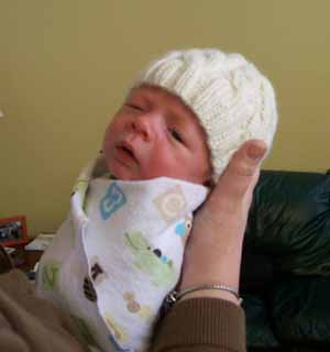 Baby Aiden in Cabled Hat